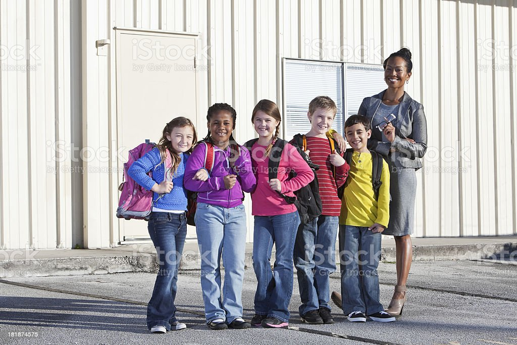 Teacher with group of elementary school children stock photo