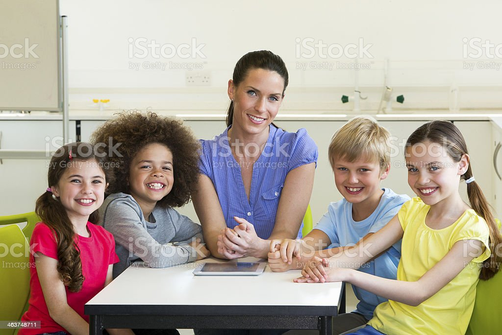 Teacher with mixed group of children royalty-free stock photo