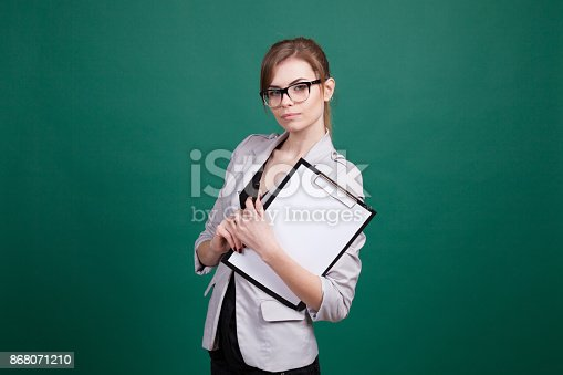 istock teacher with papers in green boards 868071210