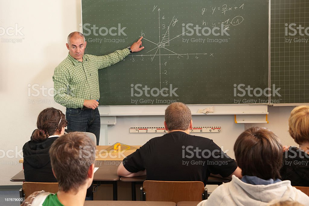 Teacher with pupils in a school lesson stock photo