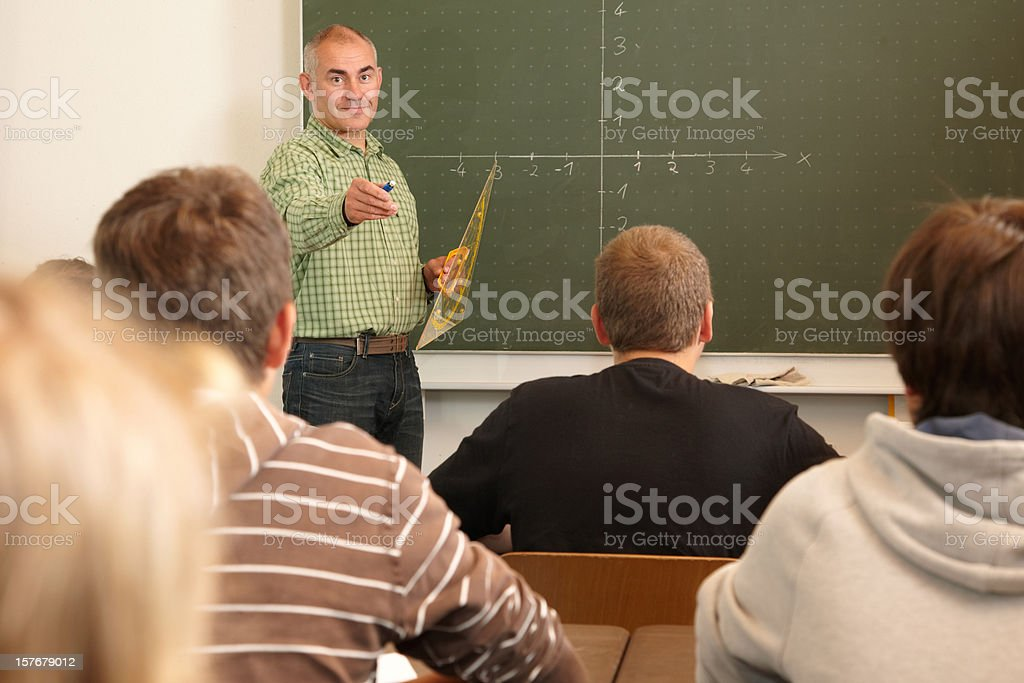 Teacher with pupils in a school lesson royalty-free stock photo