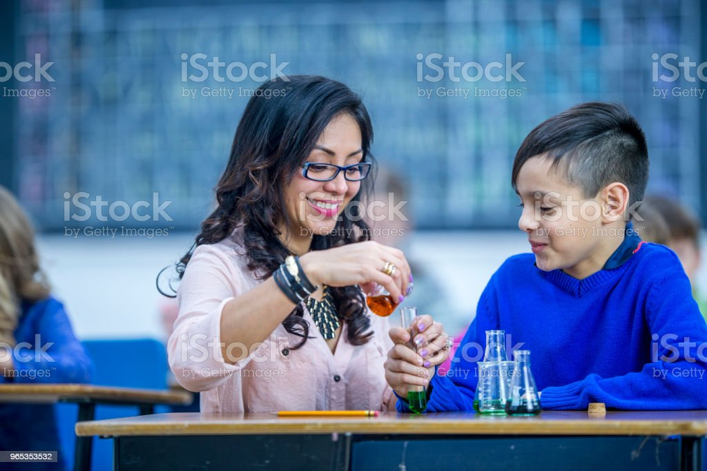 Teacher with student learning about chemistry royalty-free stock photo