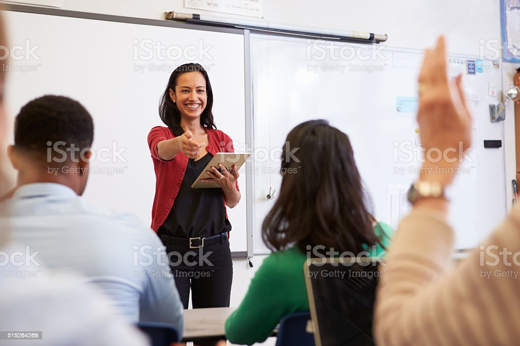 Teacher with tablet and students at an adult education class stock photo