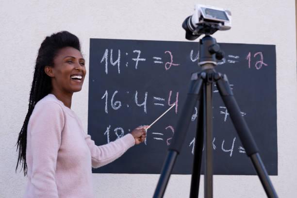 A teacher woman remote teaching during the epidemic Coronavirus. stock photo