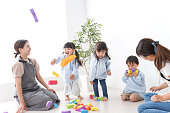 Teachers and children at kindergarten