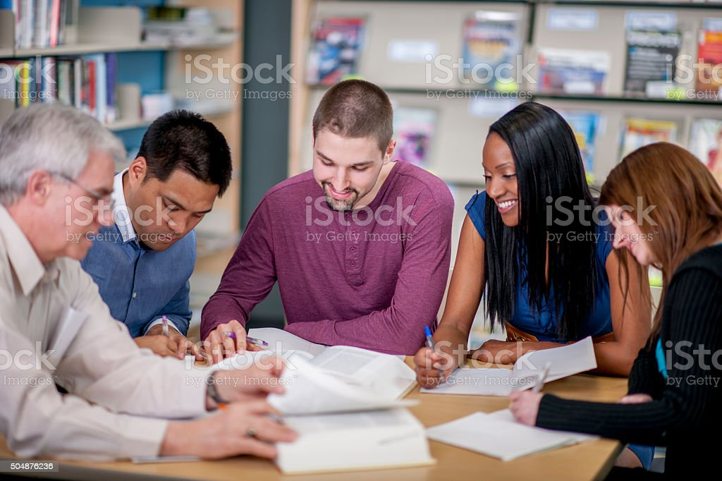Teachers Meeting in the Library stock photo