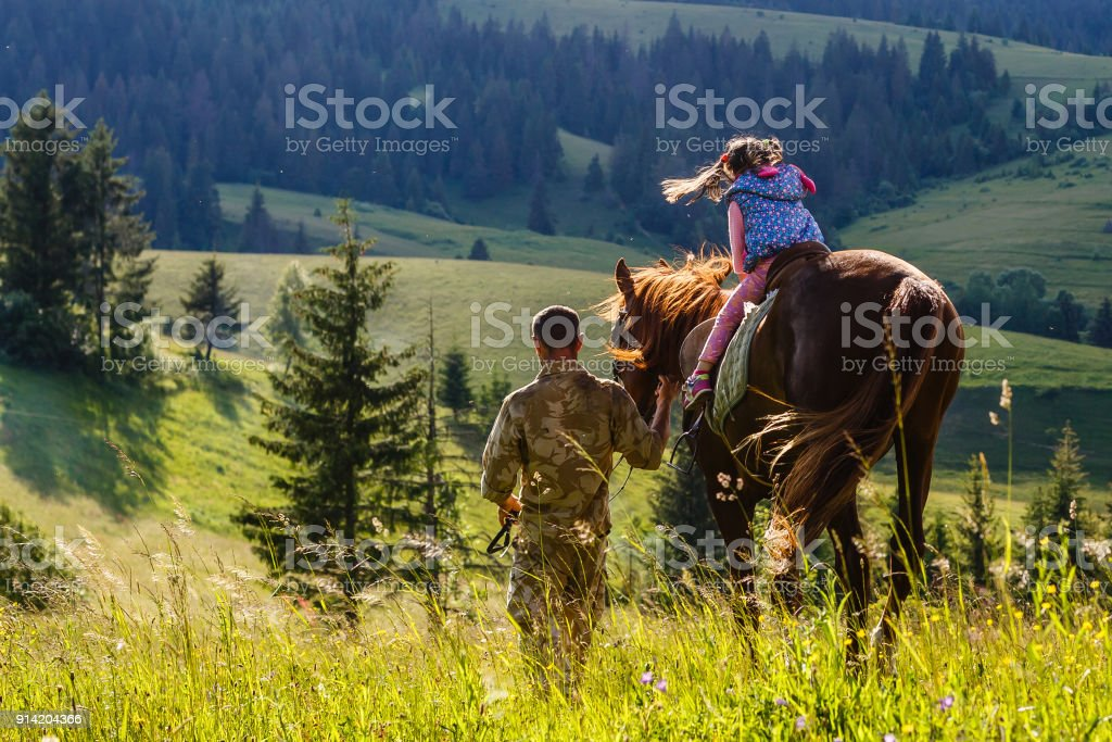 teaches girl to ride a horse. Lesson with Riding Instructor. stock photo