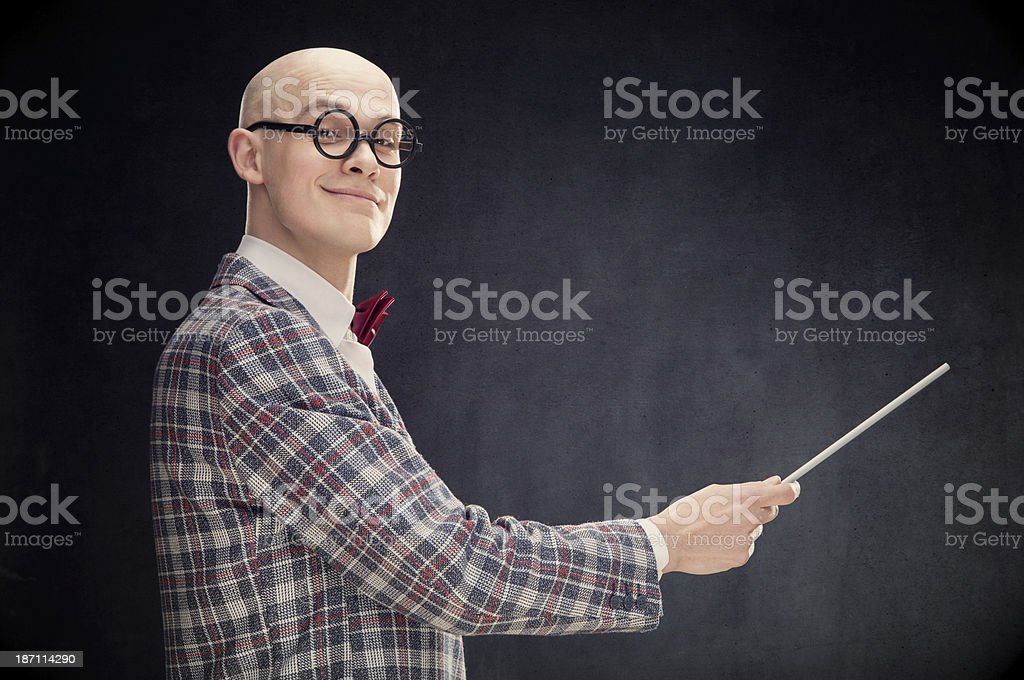 Teaching bald professor with bow tie and wand black isolated stock photo