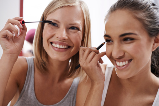 Teaching each other makeup tricks stock photo