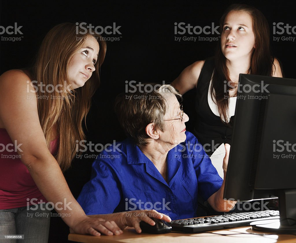 Teaching Granny the computer is frustrating for youngsters! stock photo