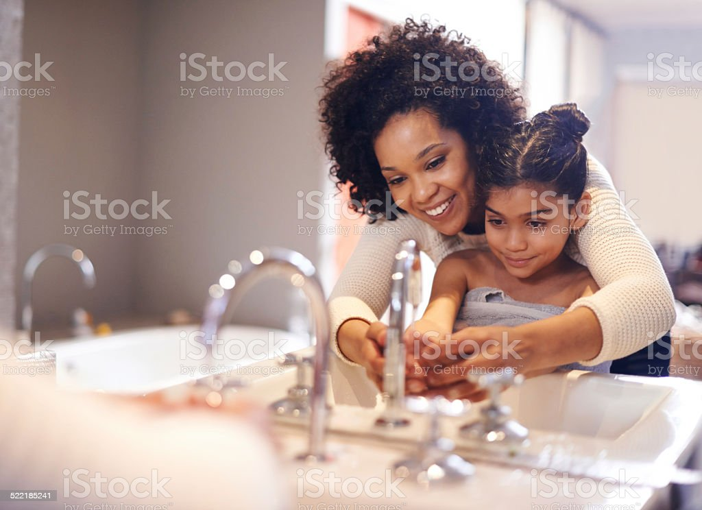 Teaching her about good hygiene stock photo