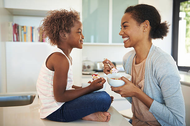 Teaching her daughter healthy eating habits stock photo