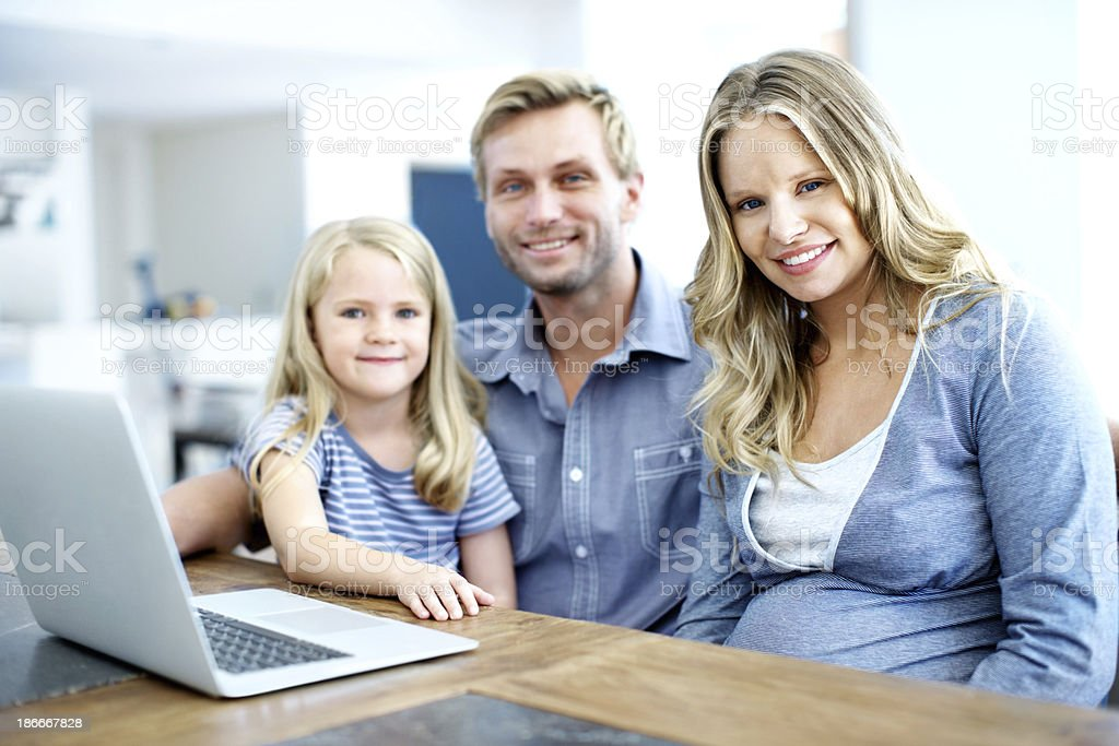 Teaching her how to use the computer royalty-free stock photo