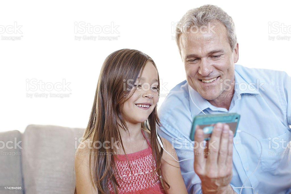 Teaching her some music appreciation royalty-free stock photo