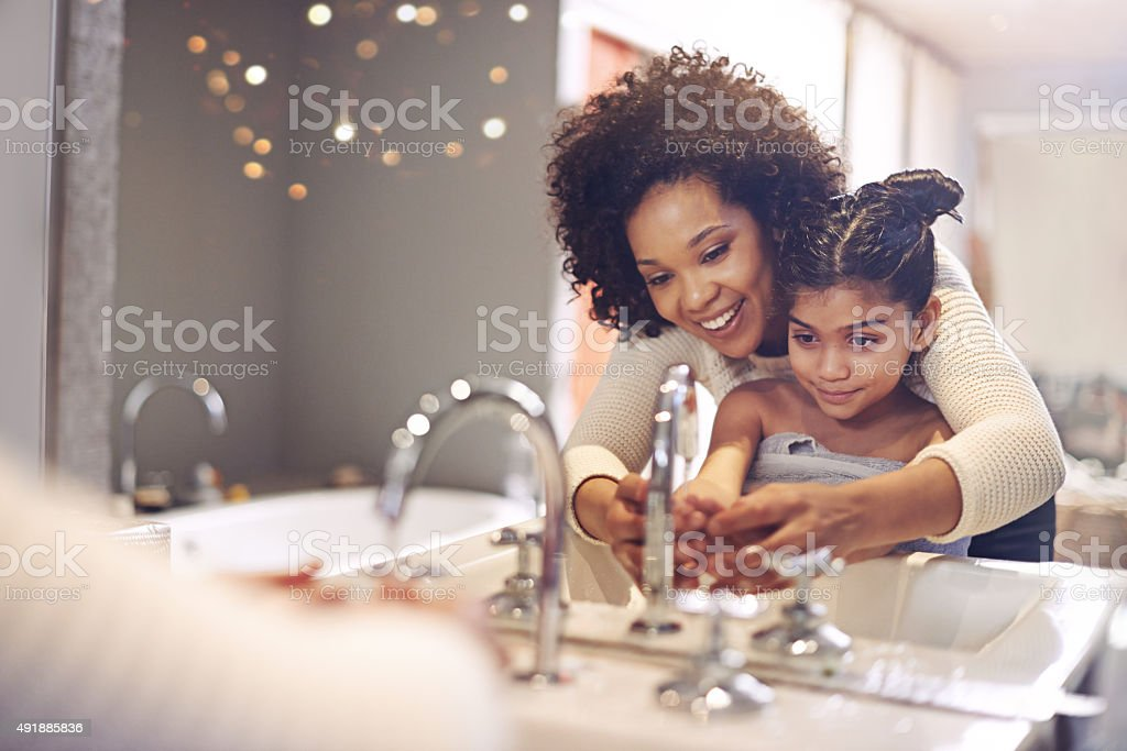 Teaching her the importance of washing your hands stock photo