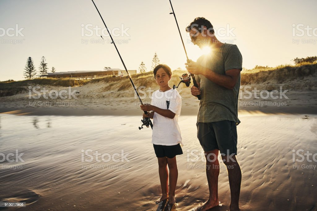 Teaching him how to fish is the best lesson stock photo