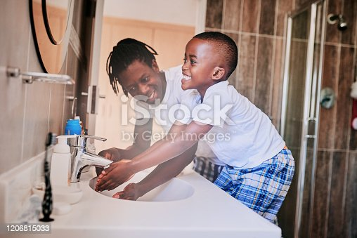 1182622704istockphoto Teaching him the importance of good hygiene 1206815033