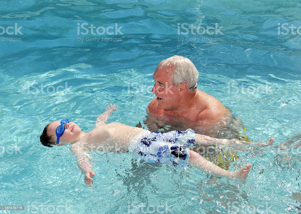 teaching him to swim royalty-free stock photo