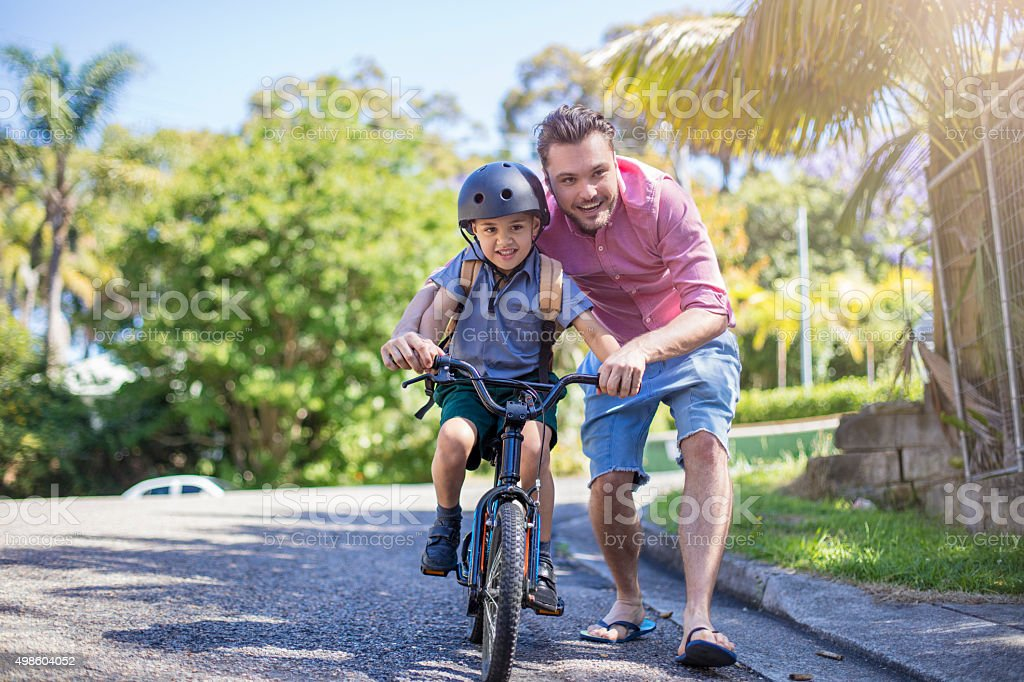 Teaching how to ride a bicycle stock photo