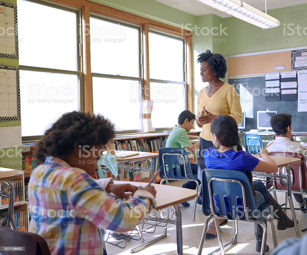 Shot of a elementary children and their teacher in a lesson at school