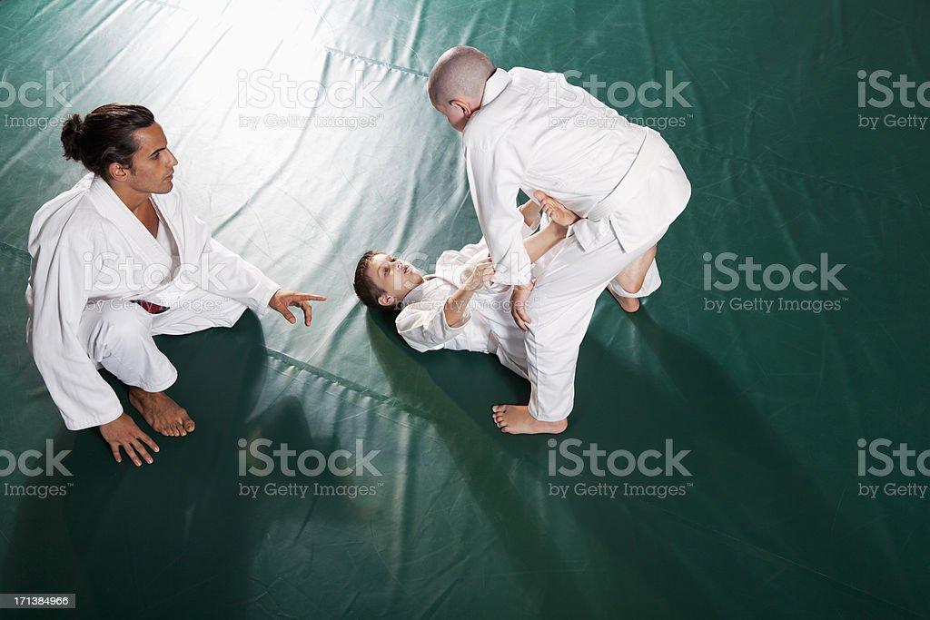 Teaching Jiu-Jitsu Open Guard position stock photo