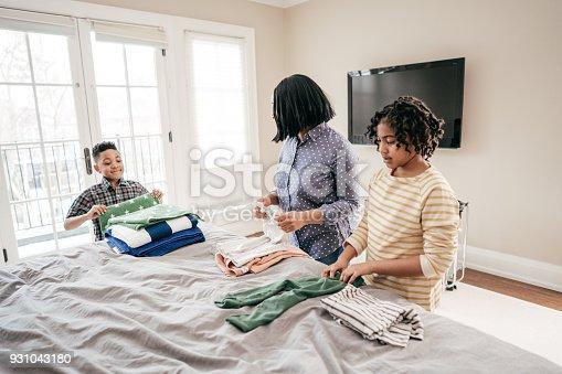954356678istockphoto Teaching kids to do their chores 931043180