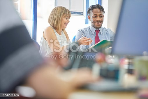 istock Teaching new employee the role 874297176