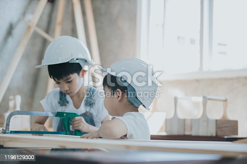 Sawing, hand saw, working, Teaching, danger,  saw, children, carpenter, boys, learning, dreaming, passion, Thailand, carpentry, effort, tired, workshop, wood- material, chid, learning, wide shot