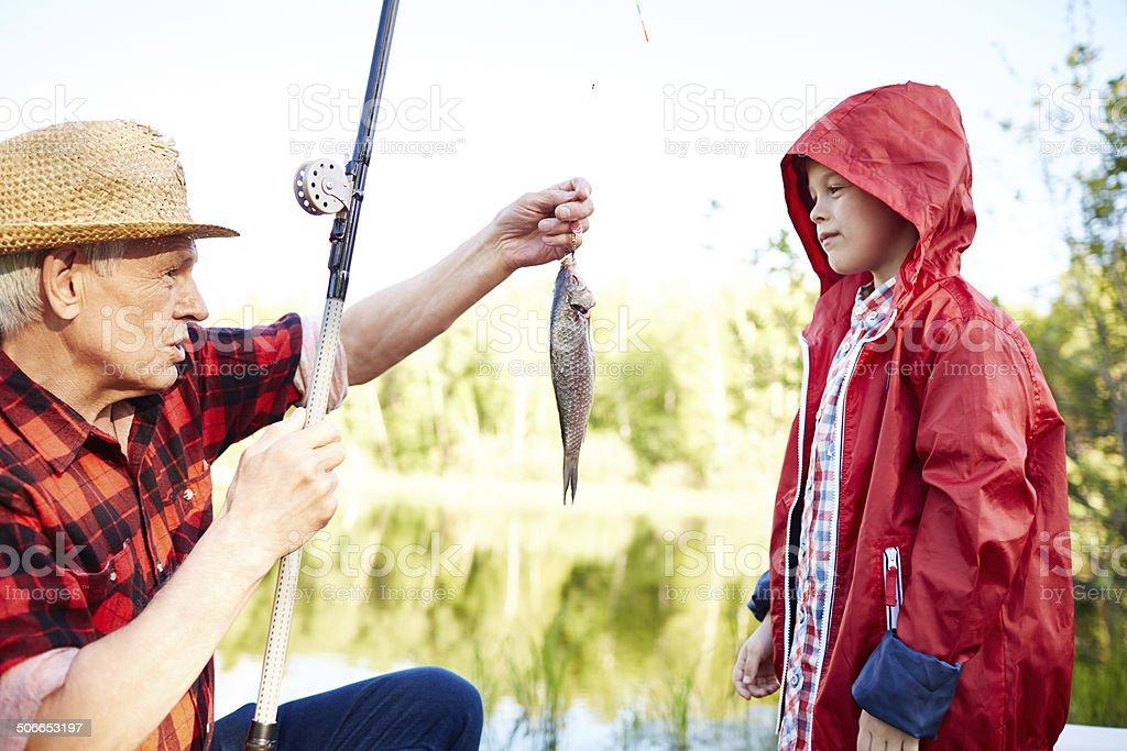 Teaching to fish stock photo