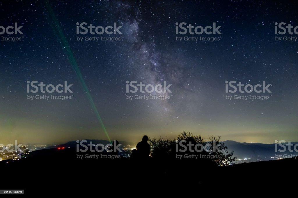 Teaching under the Milky Way stock photo