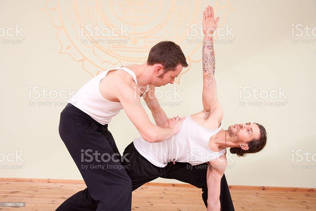 Teaching Yoga In A Studio royalty-free stock photo