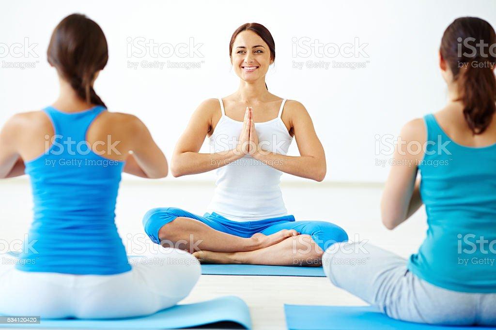 Teaching yoga stock photo