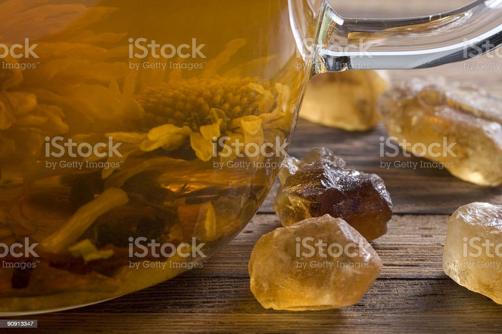 teacup with a flower tea and gold sugar royalty-free stock photo