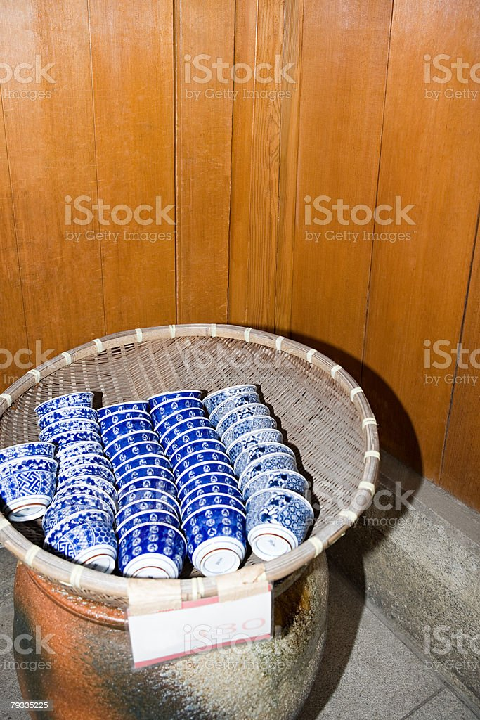 Teacups in a wicker basket royalty-free 스톡 사진