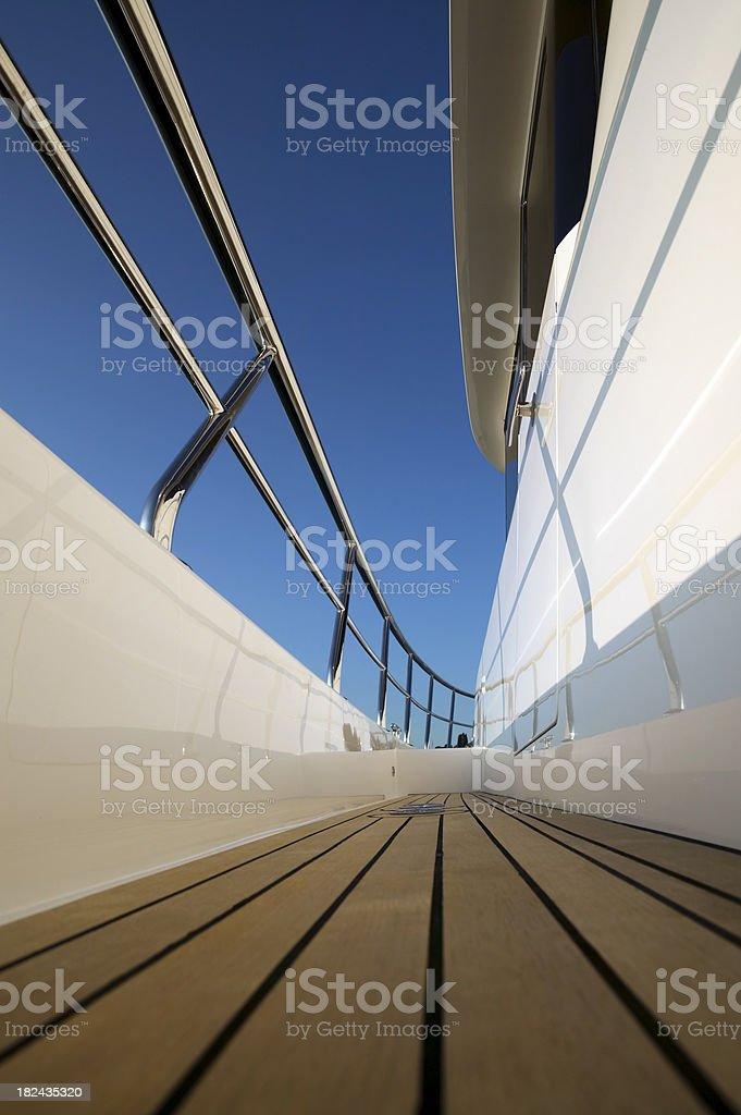 teak deck motor yacht low angle royalty-free stock photo