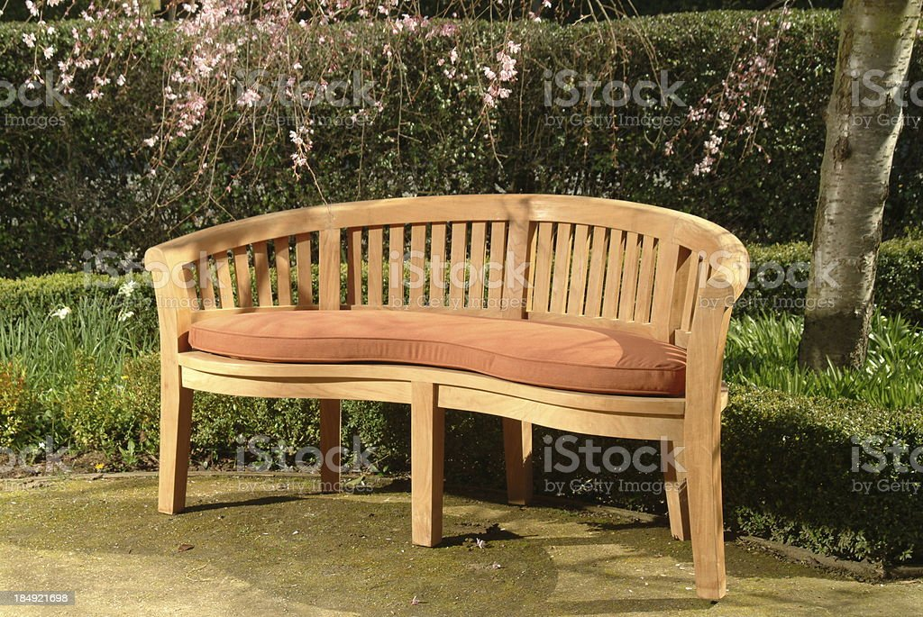 Teak Patio Bench stock photo