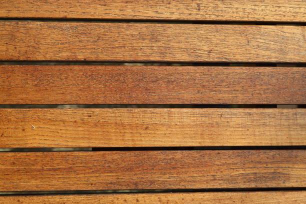 teak sticks table top - pejft stock photos and pictures