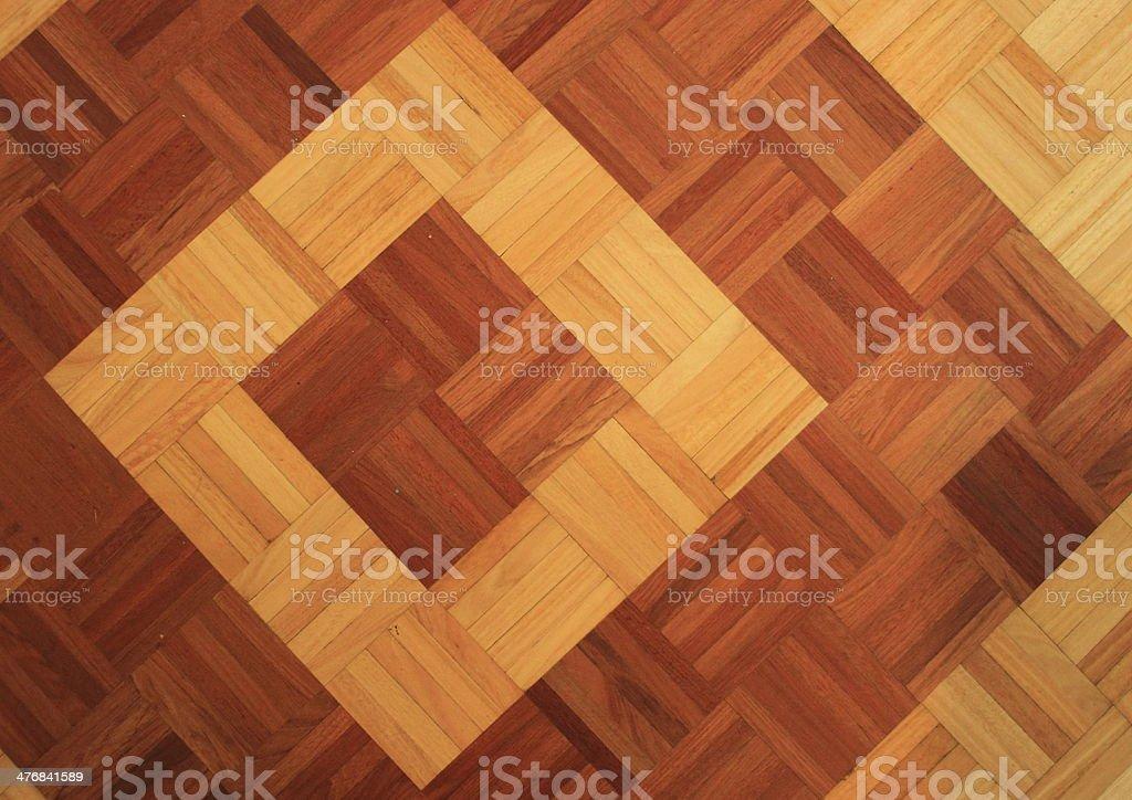 Teakwood floor of quadratic sticks forming two quadrants royalty-free stock photo