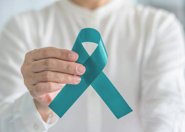 teal awareness ribbon bow color for ovarian cancer, polycystic ovary syndrome (pcos) and post traumatic stress disorder (ptsd) illness support - ovarian cancer ribbon stock pictures, royalty-free photos & images
