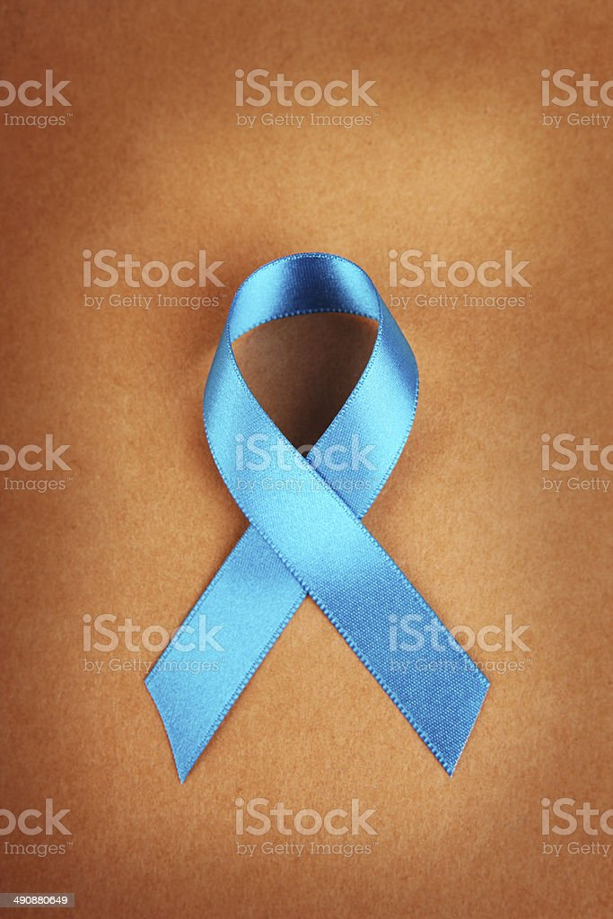 Teal Awareness Ribbon on Brown stock photo