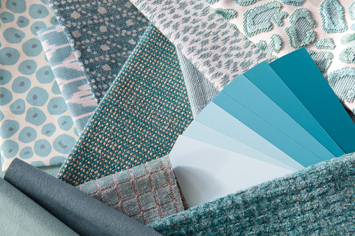 Teal or turquoise interior decoration plan with fabric samples and paint swatches