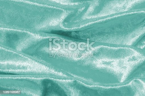 859441184istockphoto Teal blue velvet background or velour flannel texture made of cotton or wool with soft fluffy velvety satin fabric cloth metallic color material 1089168982