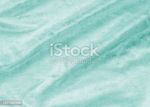 859441184 istock photo Teal blue velvet background or velour flannel texture made of cotton or wool with soft fluffy velvety satin fabric cloth metallic color material 1227052260