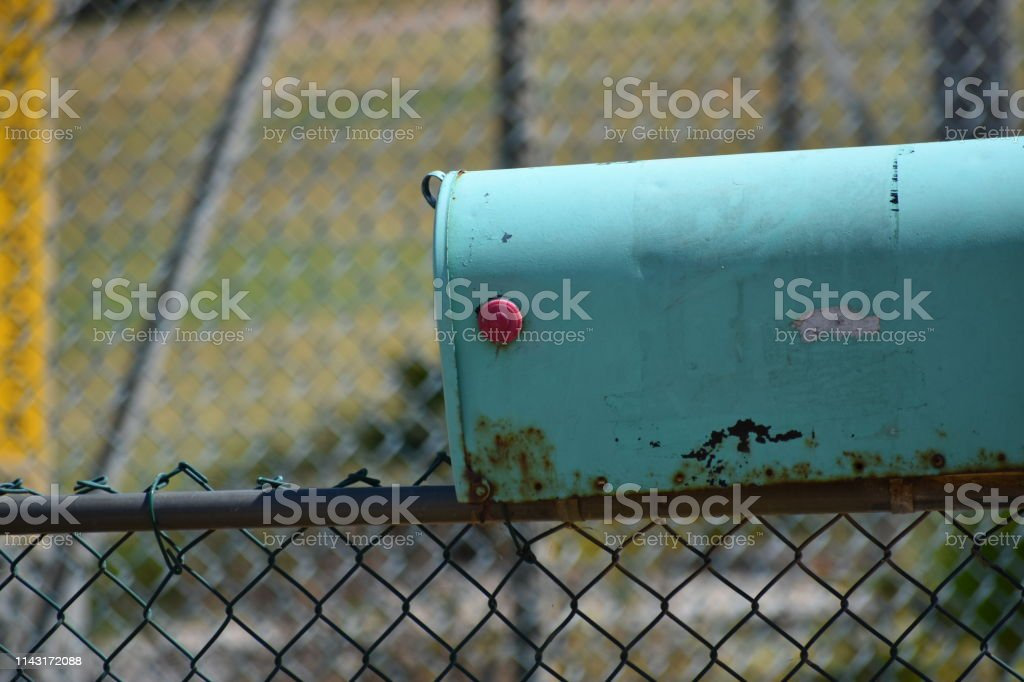 Teal Mailbox with Baseball Field in Background stock photo