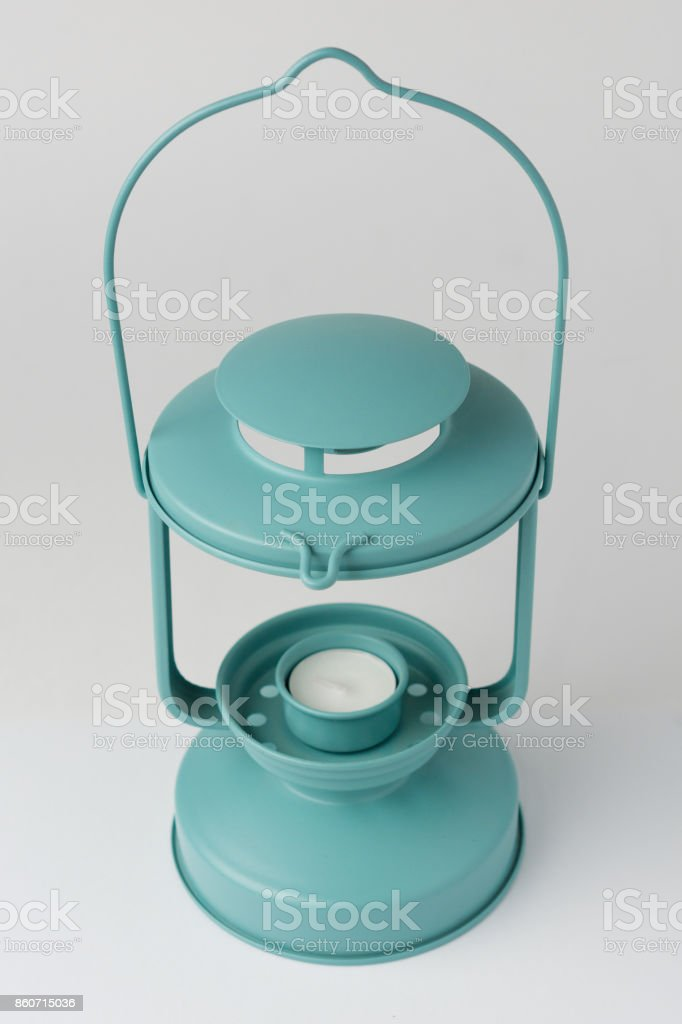 Teal Metal Candle Lantern on White Background Perspective View stock photo