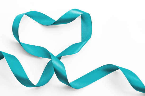 teal ribbon awareness in heart shape isolated on white (clipping path) symbolic bow color for ovarian cancer, polycystic ovary syndrome (pcos) disease, post traumatic stress disorder (ptsd) - ovarian cancer ribbon stock pictures, royalty-free photos & images