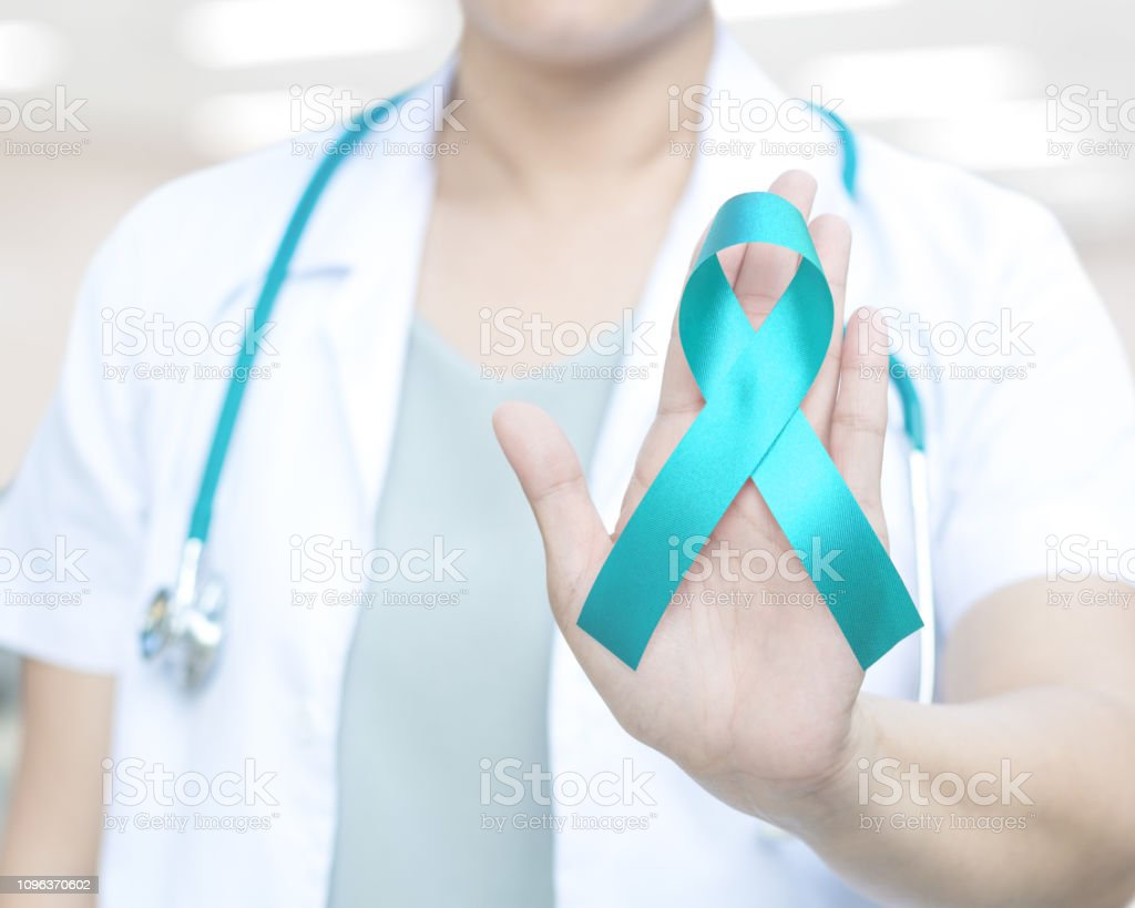 Teal Ribbon Awareness On Doctoras Hand For Ovarian Cancer Polycystic Ovary Syndrome Stock Photo Download Image Now Istock