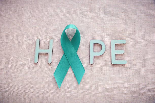 teal ribbons with hope word, ovarian cancer, cervical cancer, ki - ovarian cancer ribbon fotografías e imágenes de stock