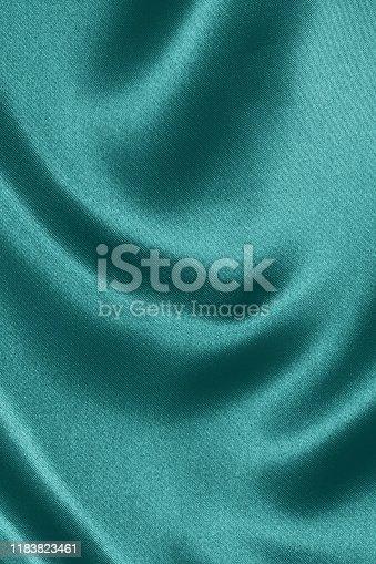 859441184istockphoto Teal satin background 1183823461