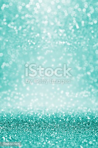1058078946 istock photo Teal Turquoise Aqua Glitter Background Texture 1055327420